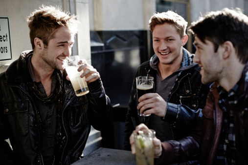464722615-male-friends-hanging-out-and-having-some-gettyimages