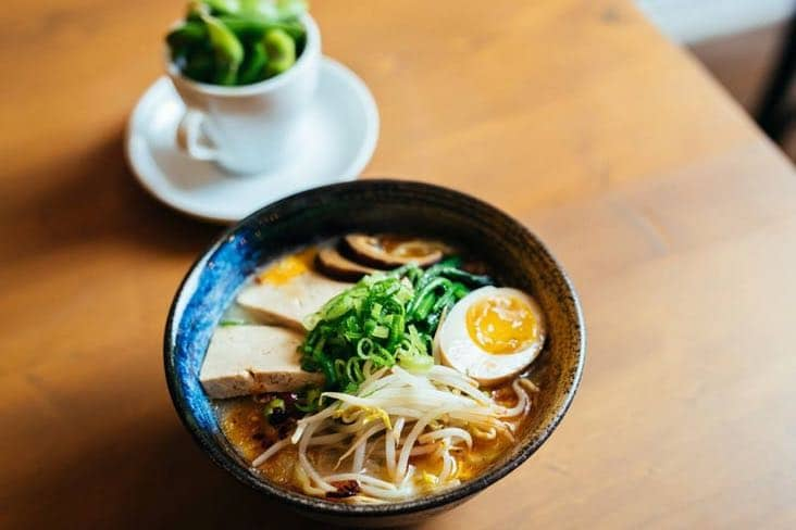 Ramen noodles with pork, egg and fresh herbs at Tsukuyomi in Mile End