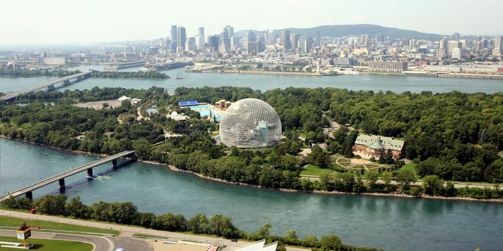 aerial view of park on island with sphere and pool