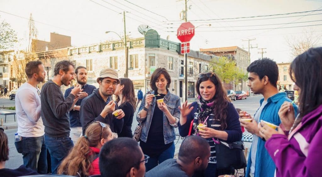 People gathered and eating ice cream on a food tour in montreal
