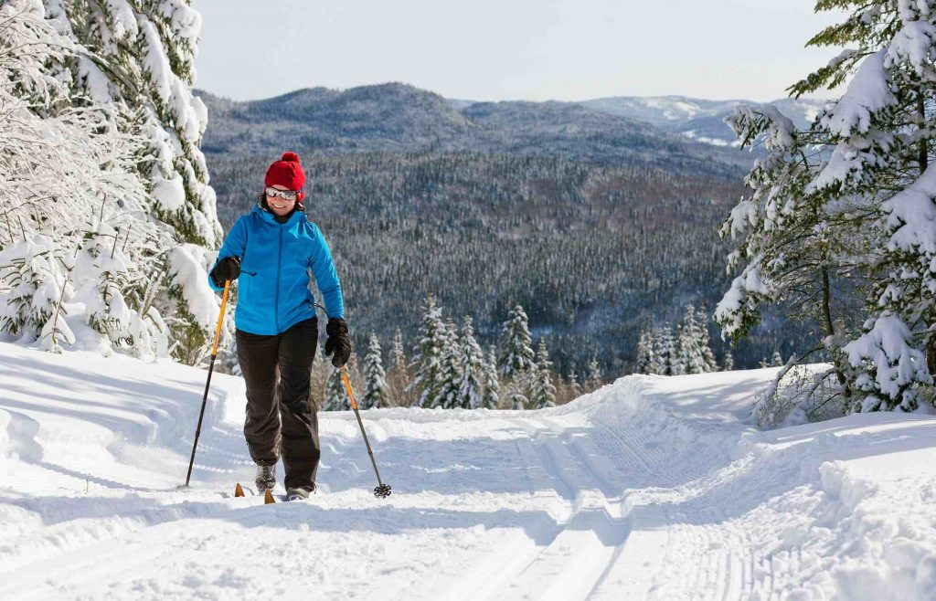 woman cross country skiing at camp mercier things to do in quebec city