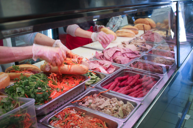 Making sandwiches at Banh Mi Nguyen Huong in Chinatown Toronto