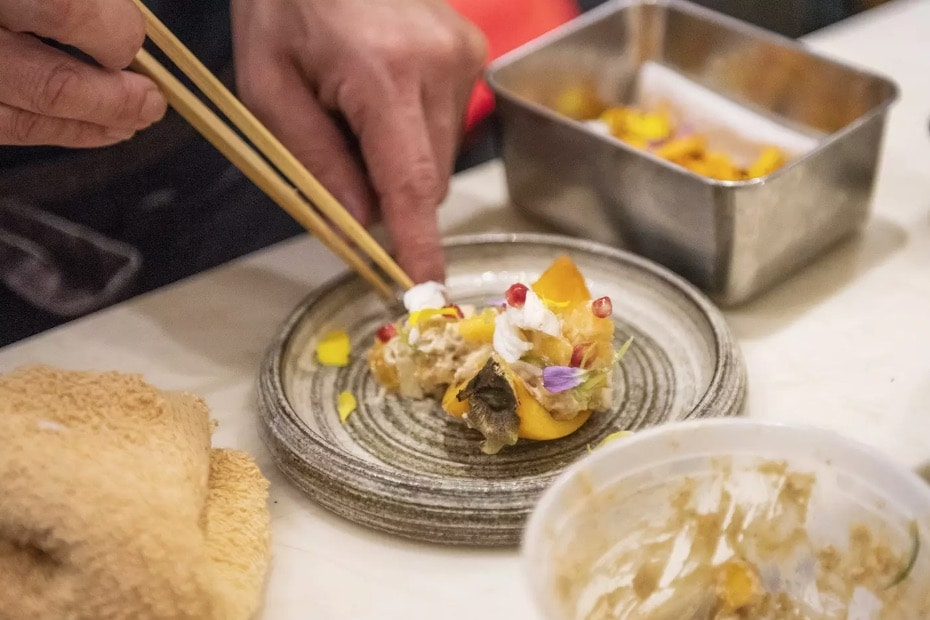 yukashi toronto restaurants chef preparing plate