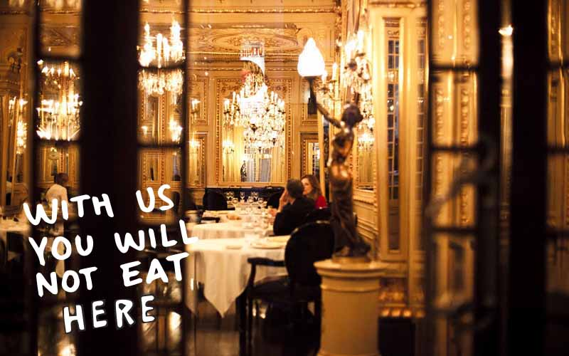"Picture of fancy restaurant with writing that states ""With us you will not eat here"""