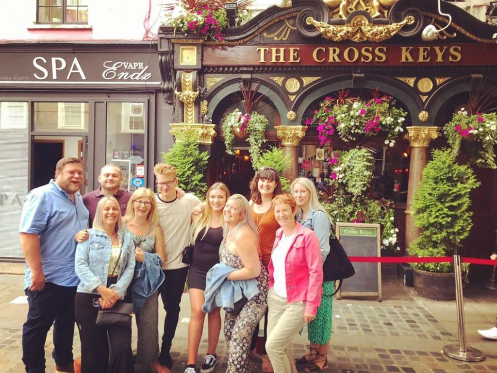 A London Pub tours group picture in front of historic London pub