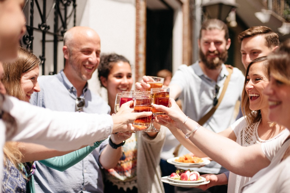 Lisbon food tours group hold up glasses to cheer