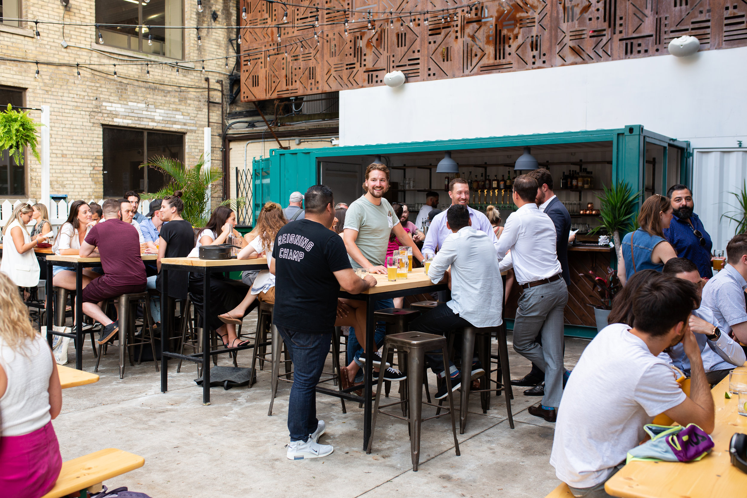 Outdoor beer garden bustling with customers on a bright day
